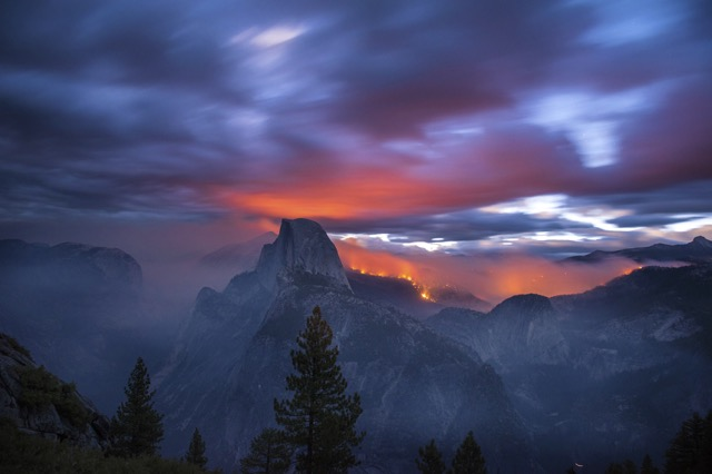 Dawn breaks as the Meadow Fire lights the forest and clouds to the northwest of El Capitan Peak in Yosemite National Park, Calif. 3:13am. 30 seconds with 24mm lens @f.4